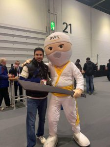 Arif with the AWS Mascot at the AWS Summit